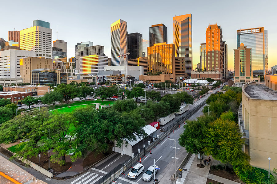 Houston TX Insurance - Houston Skyline with Skyscrapers and Road into City
